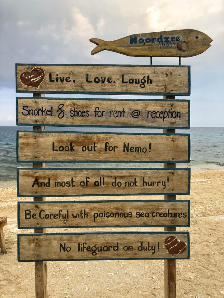 Noordze Hostel Beach Sign